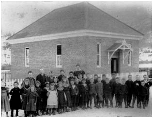 1898, Children stand in front of the brick Clinton School